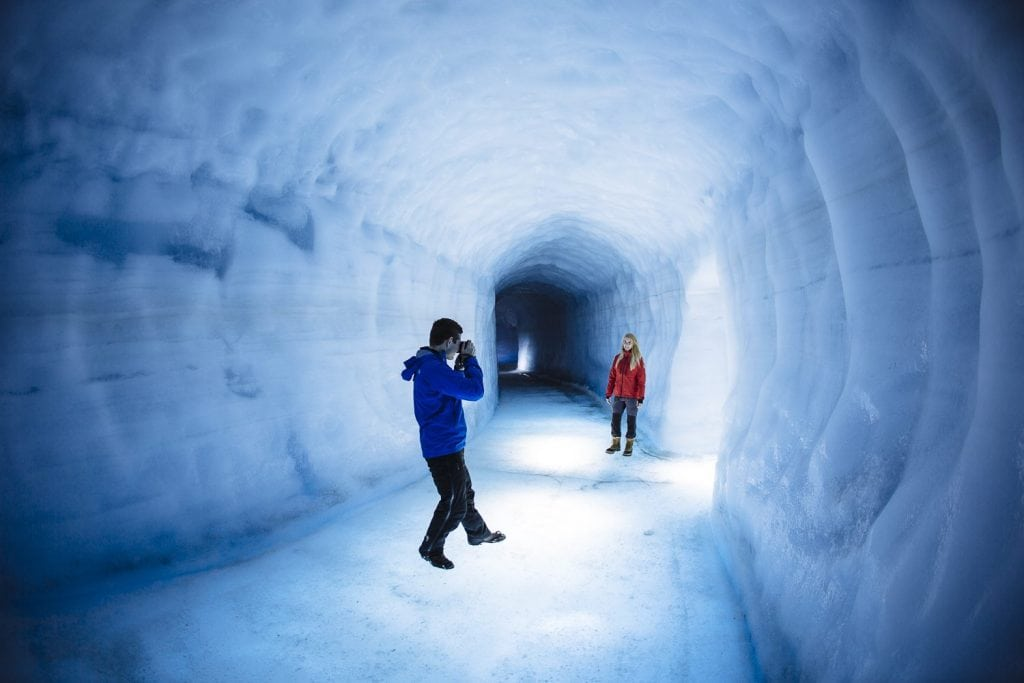 into the glacier ice tunnel