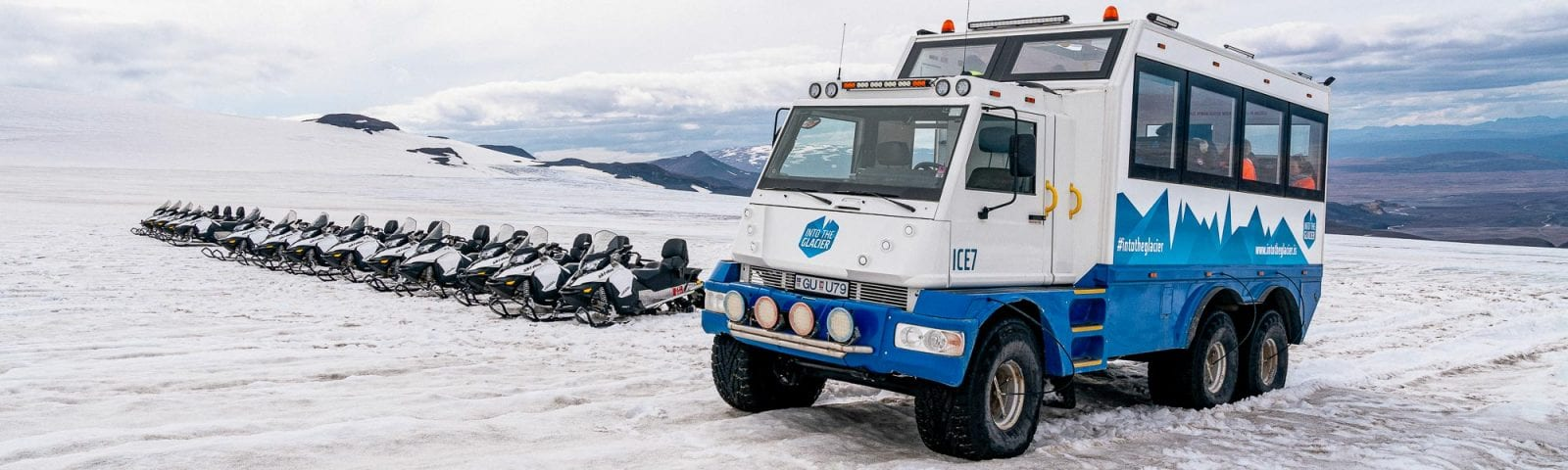 Snowmobile and truck on a glacier