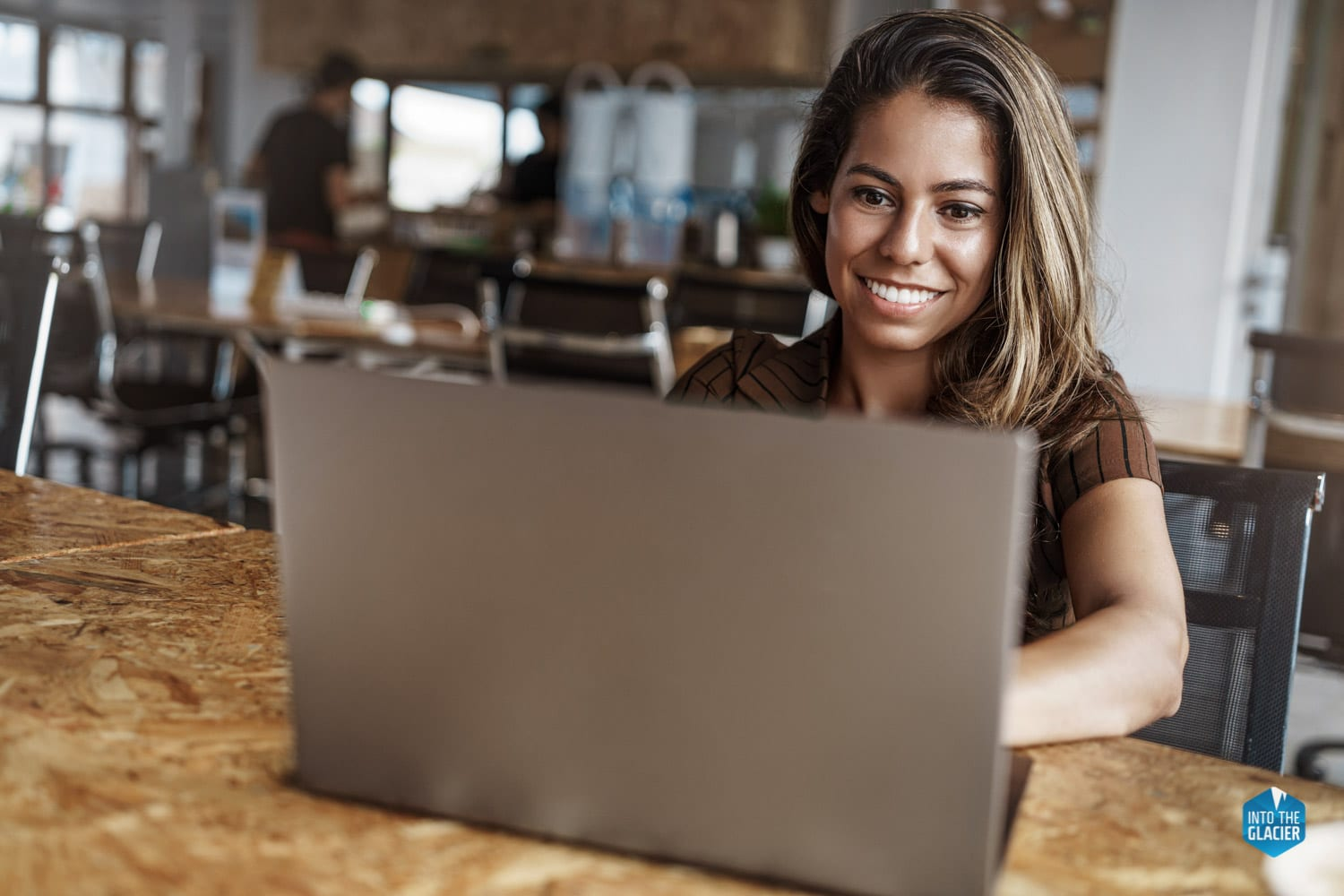 Latin woman sitting in front of laptop
